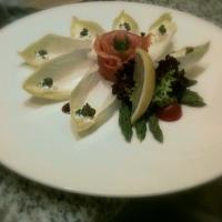 Endive salad with rosace of salmon