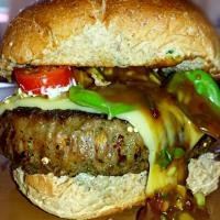 Beef Jalapeño Burger with Sweet Chilli-Mustard sauce, melted Emmental cheese, Basil &Cherry tomatoes