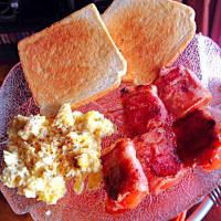 Bacon wrapped tomatoes toast and dirty scrambled eggs