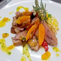 Steam the Duck breast with orange mango sauce