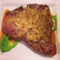 T-bone steak with sautéed onions, brandy sauce and asparagus puree