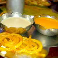 its a Indian sweet dish... love to have aam ras,  rabdi and jalebi.. yummy :)