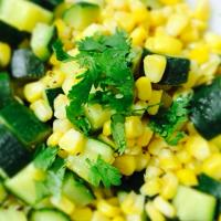 Zucchini and corn topped with cilantro and zest of lime