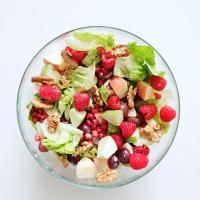Waldorf salad with pomegranate, raspberry and honey yoghurt dressing