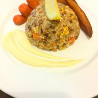 Tuna fried rice served with potato wedges and cocktail sausages
