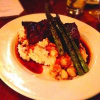 "Angus sirloin medallions with smoked paprika rub, asparagus, garlic whipped potatoes. from ""Tosca"" Hingham, Massachusetts."