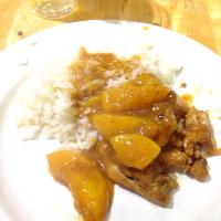 Chicken leg/thigh with a sweet and sour sauce and cooked peaches