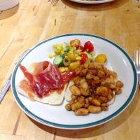 Butter beans and chickpeas in black bean sauce, toasted bread with butter and Serrano ham, and salad