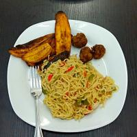 Noodles, meat balls and fried plantain