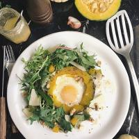 Fried egg in pumpkin,green salad,walnut and Parmesan cheese