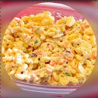Macaroni Salad~ elbow mac, shredded roasted chicken, onions, carrots, celery, green onions, pineapple, apples, dried cranberries, sweet pickles relish, mayo, mu