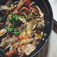 Pork stew with clams and tomatoes