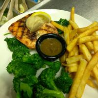 grilled salmon over spinach with broccoli and fries