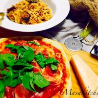 Raw ham pizza with bolognese pasta