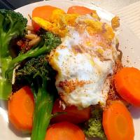 Grilled chicken, steam veggies on the side, covered with lava fried egg