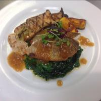 Pan Seared Bronzini with Apple Butter Jus  ,  wilted Swiss Chard, Grilled Kingoyster Mushrooms, Roasted Turnips & Kabocha Squash 。