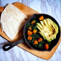 Spinach, pumpkin skillet with avocado