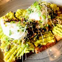 Poached eggs, squashed Avocado and Toast.