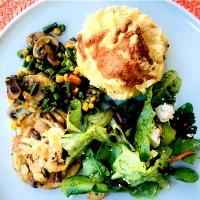 Egg soufflé, sliced roast potatoes with onions mushrooms and cheese, veggies and salad.