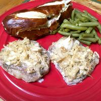 Baked Pork Loin with Black Pepper, Sour Kraut and Olive Oil; Served With Green Beans and Pretzel Roll