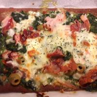linseed pizza spinach 3 cheese ham prosciutto olives