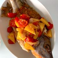 Fried fish with sweet and sour tomato sauce