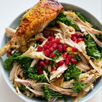 Left over Christmas turkey tossed with coriander vinaigrette, kale and pomegranate