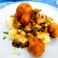 Potato mash with mushroom, corn, peas, carrot and cheese mix with crumbed cauliflower