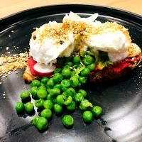 Poached eggs, peas, beetroot hummus, radish & dukkah spices on a slice of sourdough