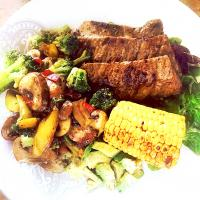 Pan-Grilled Flank Steak, Vegetable Stir Fry, Fresh Green Salad, Fresh Avocado, Garlic-Olive Oil Dressing, Spicy Buttered Roasted Corn