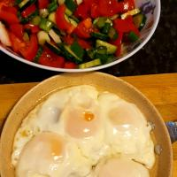 Eggs with salad for breakfast
