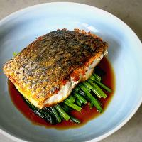 Pan seared barramundi with blanched spinach