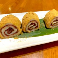 Red bean glutinous rice rolls topped with peanut