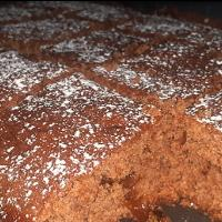 ginger chocolate brownies with some orange marmalade and a dust of cinnamon sugar