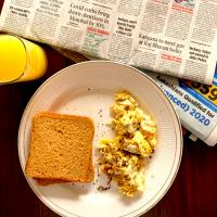 scrambled eggs two. wheatbread slices ....and the pulpy glass of health