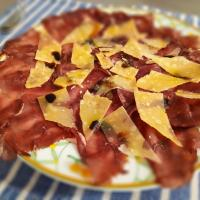 Aired-cured beef (bresaola) with parmesan flakes
