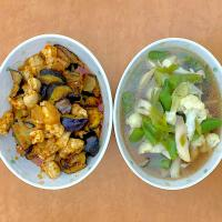 "Dinner with fried eggplants and chicken in ""chili sauce"" which is completed with vegetables in souyu soup"