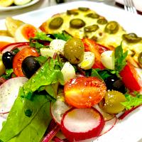 simple salad dressed with black truffle salt and extra virgin olive oil