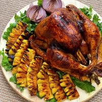 Roasted satay turkey with grilled pineapples