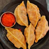 Chicken pizza Momos