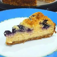 a slice of blueberry crumble cheese cake