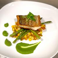 Pan seared striped bass with grilled corn salsa and basil herb purée