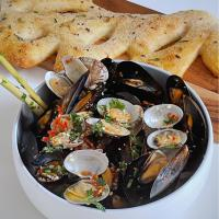 Lemongrass mussels and clams served with fougasse
