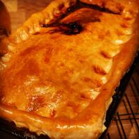 Just finished baking my Pork onion & Apple Pie letting it cook down  My first time at making