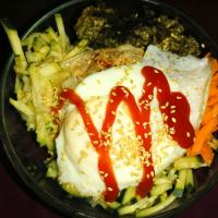 "bibimbap   Bibimbap, is a popular dish of Korean cuisine, literally means ""mixed rice"" or ""mixed food"".  It consists of a bowl of rice with vegetables and meat"